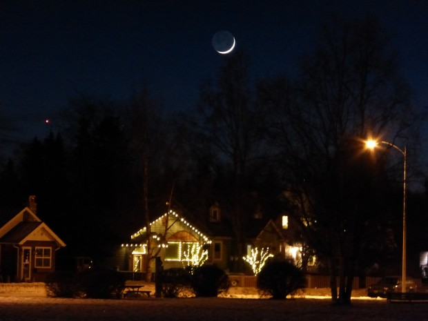 First sliver of waxing moon over the Park Strip (6:28 pm, 1.21.15, Anchorage, Ak)